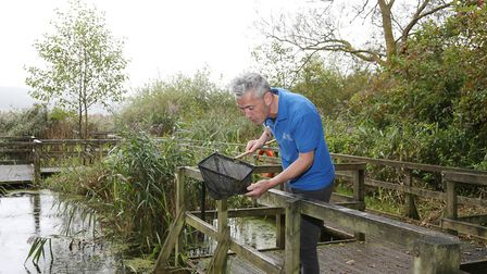 Jon Carter, Visitor Experience Manager at RSPB Leighton Moss checking the reserves pond