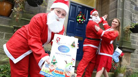Anna Saczek, Richard Cogger and Anna Webster practise their salsa moves for the CancerCare Santa Salsa in Lancaster