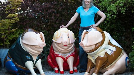Eveyln with Piggles, Pigling Blonde and Ham Solo, who she created for a Pig Trail in the Cotswolds