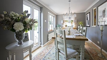 DINING ROOM Table and chairs from West Country Pine. Chandeliers from John Lewis
