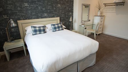One of the stylish rooms now open to guests at 1823 Spinning Block Hotel