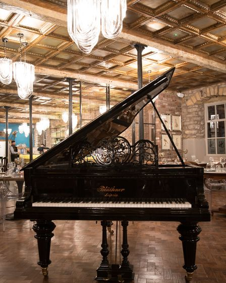 The bar features a grand piano