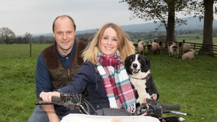 Robert and Pamela Whitwell with sheepdog Jess on a quadbike. Lonks in the background