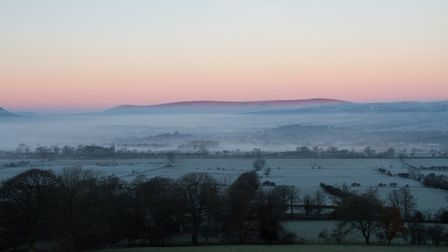 View over Whitwell sheep and fields into Clitheroe