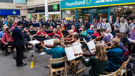 The orchestra playing for shoppers