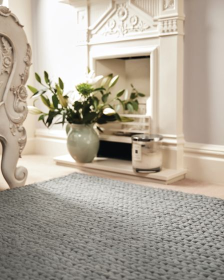 Liven up simple wooden floors with a handwoven style rug