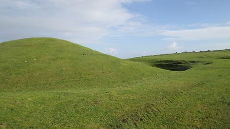 Barrow and ditch on Bronkham Hill