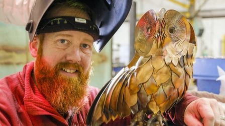 Blacksmith Chris Brammall with the owl close to completion
