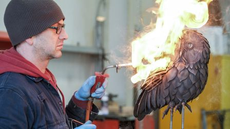 Firebird! Fabricator John Hartley adds a wax patination to this life size tawny owl created from ove