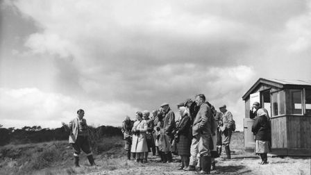 A group of people, listening to a guide at the RSPB Minsmere Reserve, 1963