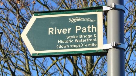 Follow the river path sign
