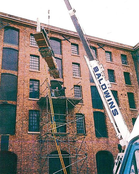Antony Gormley's Glider is craned into the third floor at Tate Liverpool in 1993
