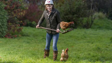 Jane Howorth, the inspirational founder of the BHWT, and a couple of hens helping with the chores (c