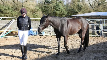 Victoria Smith with Charlie the horse, doing part of the Join Up programme where the horse is encour