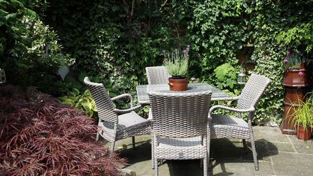 A sunny seated area in the courtyard