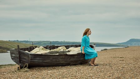Saiorse Ronan as Florence on the windswept shores of Chesil beach