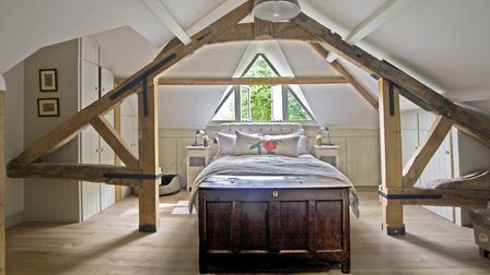 Bed from Loaf, side tables from Solid ID, cushion in French linen, chest from Suffolk House, Yoxford
