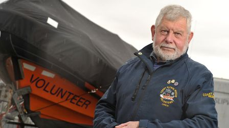 John Cresswell with The Felixstowe Volunteer Coast Patrol Rescue boat at Levington Marina, which is
