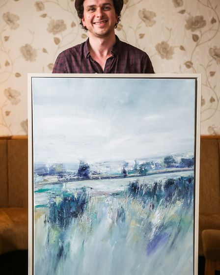Steve Rostron with his painting which won first prize last year