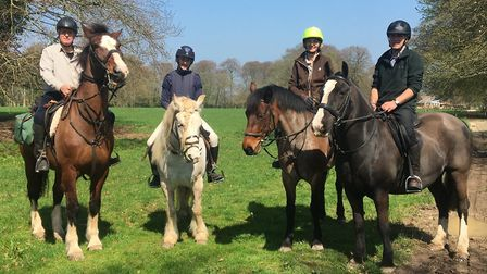 Four riders and their mounts ready for a Dorset adventure