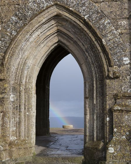 The view through the arched doorway of St Michael's Tower, on Glastonbury Tor (c) National Trust Ima