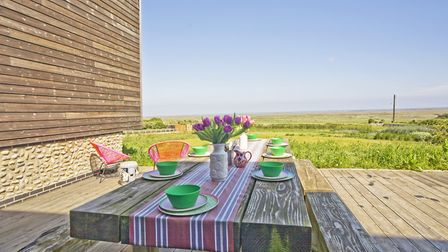 Terrace overlooking the marshes in the sun (Tony Hall Photography)