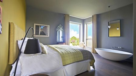 Bed by Savoir beds, 0207 4934444; Cushions by Jeanne Laine, jeannelaine.com; Curtains by Osborne and