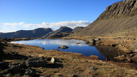 Looking across Three Tarns to the Scafells on the way up to Bow Fell (c) Vivienne Crow