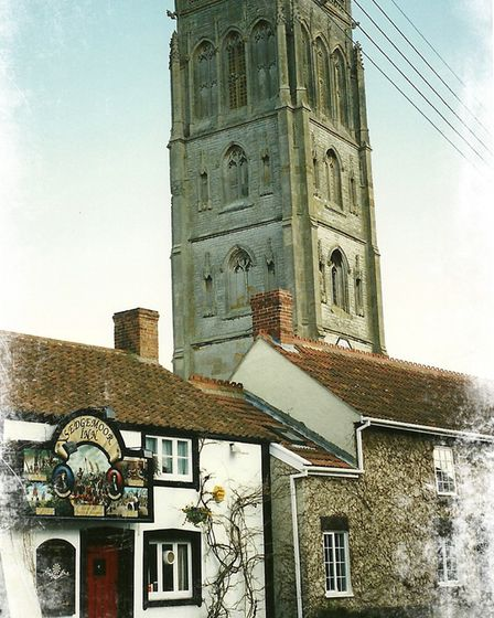 St Mary the Virgin, Westonzoyland, and behind it, the tower of St Mary the Virgin