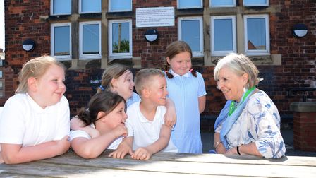 Elizabeth with pupils from her old primary school