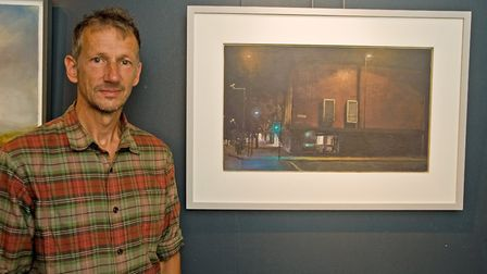 Chris Rigby with his winning urban landscape, All the Lights on Green has recently been sold by Hepp
