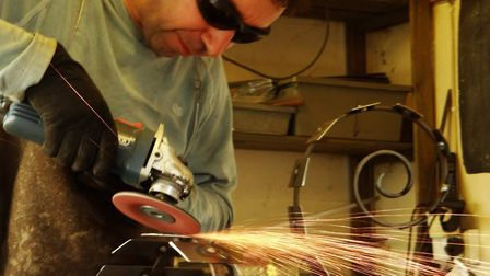 Chris Kampf works with metal to create his sculptures