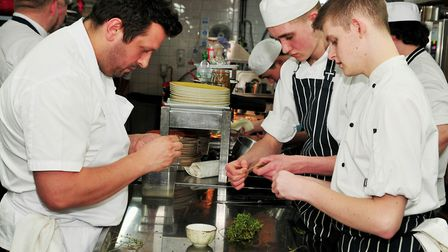 Chef Steve Groves at work in the kitchen student chefs