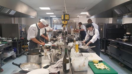 Chefs and young chefs get fown to work in the kitchen