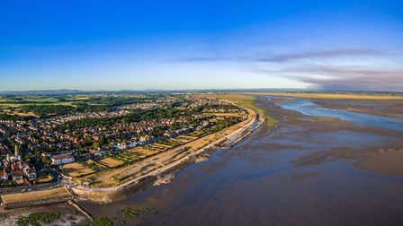High above the Ribble, Fairhaven and Lytham this summer as smoke billowed from Winter Hill (right o