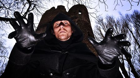 Norwich Ghost Walks storyteller, The Man in Black, hands over the role to the Shadowcaster (photo: A