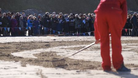 Members of the public gather on Porthmeor Beach, St Ives, for filmmaker Danny Boyle's Pages of the S