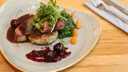 Goosnargh Duck Breast- cooked pink with fondont potato, savoy cabbage and fresh cherries