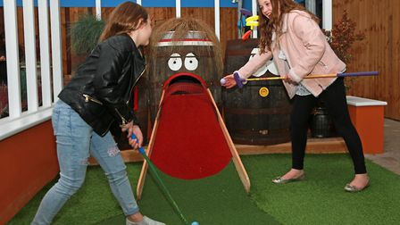 Leah (9) and Emma Harrison (11) from Preston playing Crazy Golf