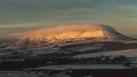Pendle Hill in a purple haze of winter - the Lancashire landmark that has inspired so much more than