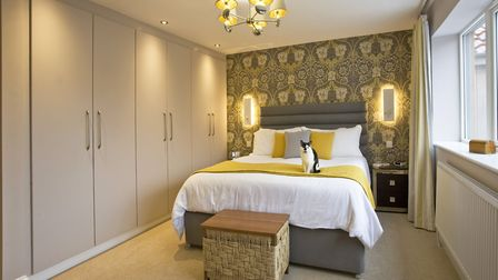 Wall lights from Astro Lighting; throw from John Lewis; bed from Made.com; Sprint headboard by Tempu