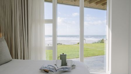 Doors in the bedrooms open directly into the gardens and onto the beach beyond
