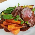 Venison haunch with dauphinoise potato, confit carrots, savoy cabbage with dark chocolate and red wi