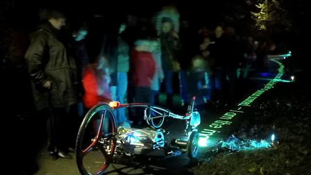 Glow Poetry installation and NYX, the mobile Poetry Robot designed by Amsterdam-based artist Gijs Va