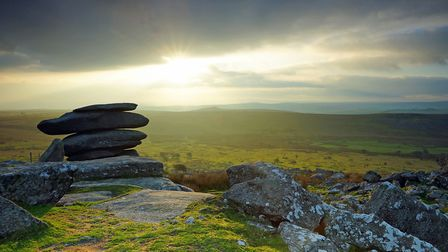 Sunset over the Cheesewring, a natural Tor on Bodmin Moor. Photo credit: Peter Llewellyn, Getty Imag