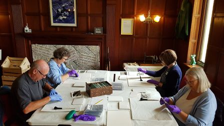 The volunteers at work on conserving the photos