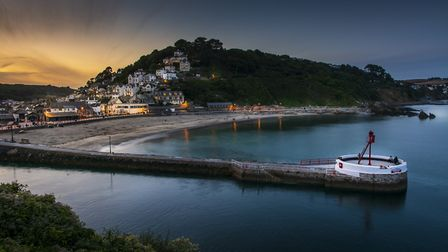 View over Looe Harbour at sunset. Photo credit: David Eastwell, Getty Images/iStockphoto