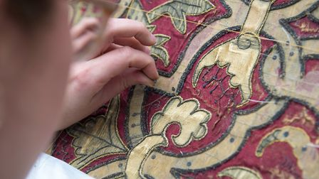 Restoration of the bed cover of the Spangled Bed (photo: Steve Adams)