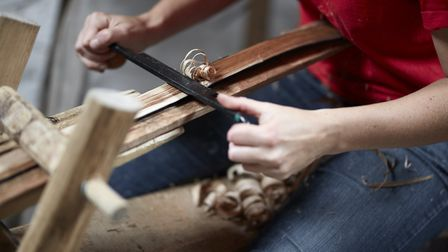 Shaping spelks on the shavehorse using a drawknife