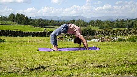 Each day starts with yoga (Picture: Andrew Nicholaides)